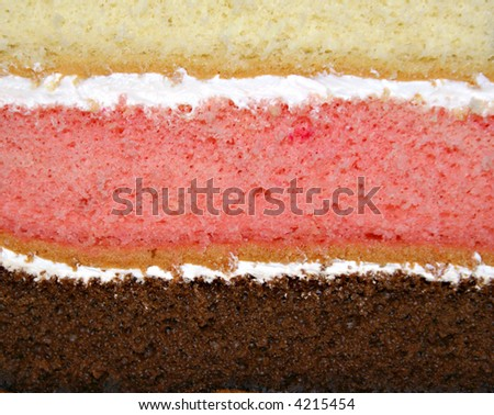 Rainbow cake close up - 3 layered cake - stock photo
