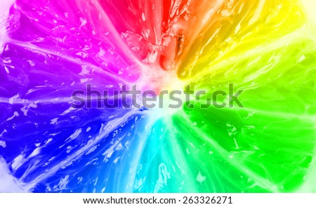 Rainbow citrus texture - lemon texture colorized with rainbow colors - stock photo