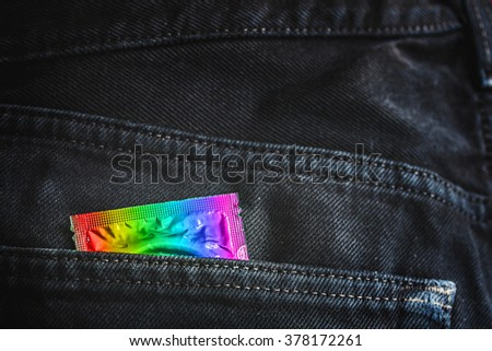 rainbow color condom pack in back pocket jeans,abortion concept. - stock photo