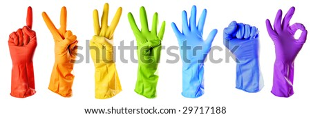 rainbow color rubber gloves on white with clipping path - stock photo