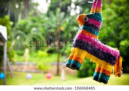 Rainbow colored donkey pinata - stock photo