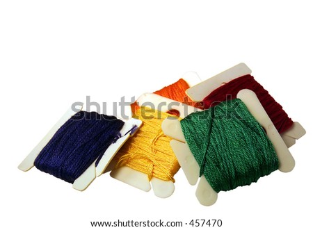 Rainbow colored embroidery floss isolated on a white background. - stock photo