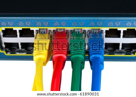 Rainbow colored ethernet network cables connected to a switch isolated on white background. Top view