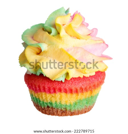 Rainbow colored muffin isolated on white background - stock photo