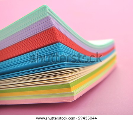 Rainbow colored paper - stock photo