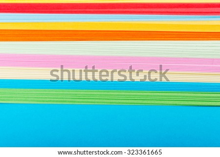 Rainbow colored paper close up