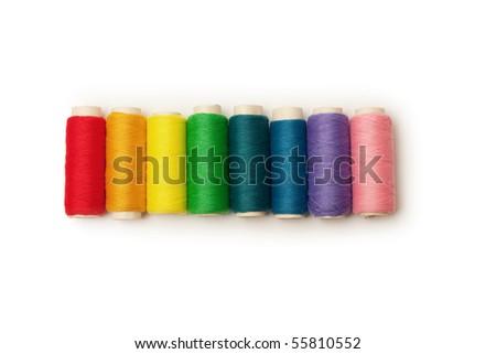 rainbow colored set of threads - stock photo