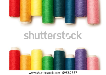 rainbow colored threads set isolated over white background - stock photo