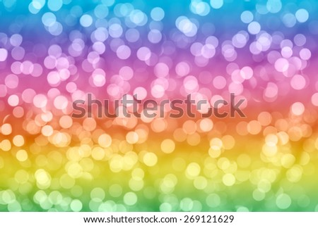 Rainbow colorful background with natural bokeh defocused sparkling lights. Bright and vivid texture with twinkling lights - stock photo