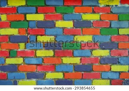 Rainbow colorful brick wall background - stock photo