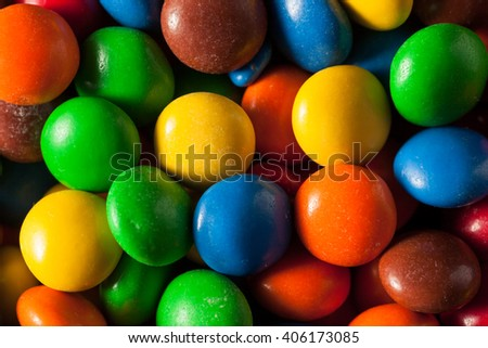 Rainbow Colorful Candy Coated Chocolate Pieces in a Bowl
