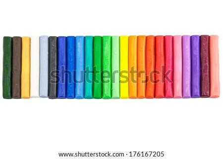 Rainbow colors clay (plasticine) isolated over white - stock photo