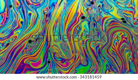 Rainbow colors created by soap, bubble,or oil makes can use for background  - stock photo