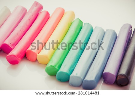 Rainbow colors plasticine play dough modeling clay isolated over white.pastel - stock photo