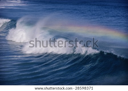 rainbow crashing over ocean wave in the Atlantic Ocean off the coast of North Carolina.