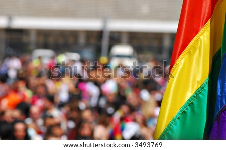 Rainbow flag at Gay pride parade - stock photo