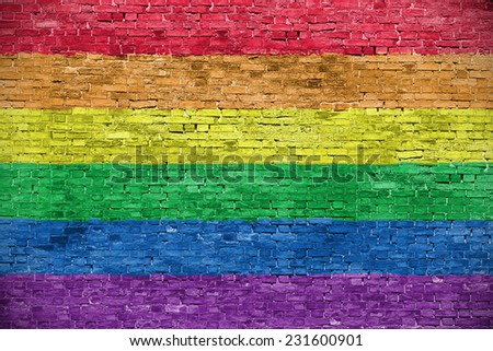 Rainbow flag over old brick wall