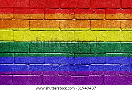 Rainbow flag painted onto a grunge brick wall - stock photo