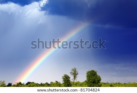 Rainbow forming after the storm. - stock photo