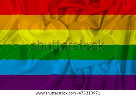 Rainbow Gay and LGBT Flag on texture satin cloth with the image of heart. 3D illustration