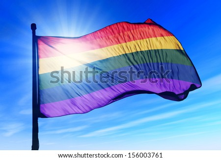 Rainbow gay pride flag waving on the wind - stock photo