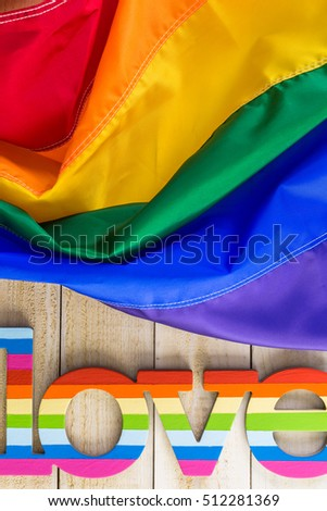 Rainbow Gay Pride flag with Love sign.
