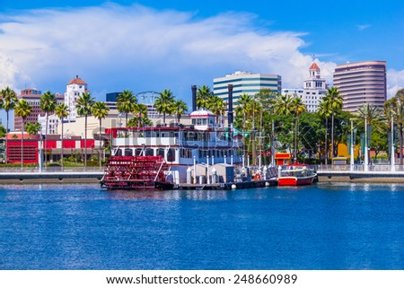 Rainbow Harbor with city skyline, boats and paddle wheel boat at Long Beach , CA  - stock photo