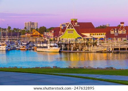 Rainbow Harbor with Shoreline  Village at sunset in  Long Beach , CA  - stock photo