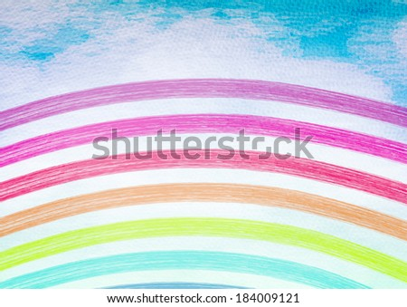 Rainbow in the blue sky. Abstract colorful background.