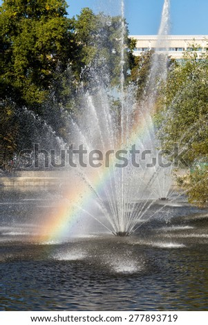 Rainbow in the fountain. Komsomolskiy pond with Fountains in sunny day, Lipetsk, Russia - stock photo
