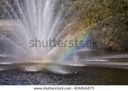 Rainbow in the fountain. Komsomolskiy pond with Fountains in sunny day, Lipetsk, Russia