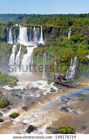 Rainbow in the right corner of the frame on the Iguassu Falls, Brazil - stock photo