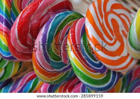 Rainbow lollipops - stock photo