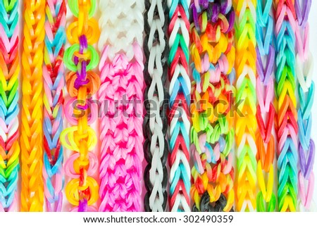 Rainbow loom- Colored rubber bands for weaving accessories - stock photo