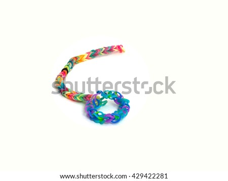 Rainbow loom, Colored rubber bands for weaving accessories isolate white background