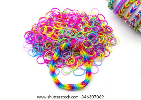 Rainbow loom Colored rubber bands for weaving accessories on a white background