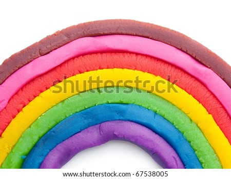 Rainbow made from dough, isolated on white. - stock photo