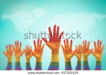 Rainbow multi-color flag pattern on blur many people human hands raising upward on world map blue sky background+clipping path: LGBT equal rights movement: Equality concept campaign conceptual idea - stock photo