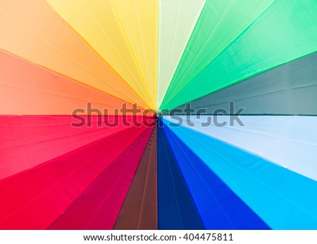 Rainbow multicolored umbrella - stock photo