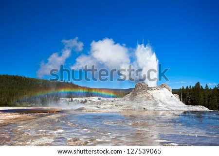 Rainbow near Castle geyser, Yellowstone National Park, Wyoming, USA - stock photo