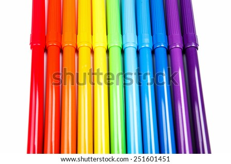 Rainbow of colored felt tip pens isolated on white - stock photo