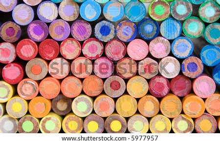 rainbow of pencil crayons - macro - stock photo