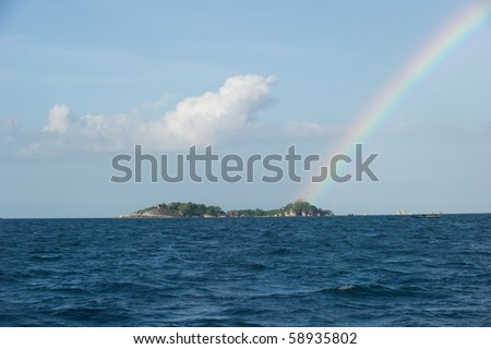 rainbow on top of an island at belitung indonesia - stock photo