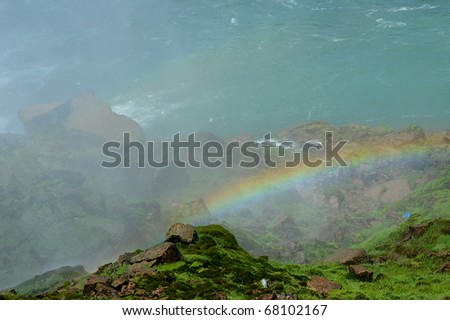 Rainbow over a hilltop near Niagara Falls, New York, USA - stock photo
