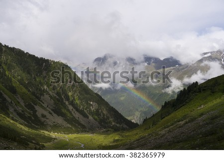 Rainbow over an Austrian mountain valley in Tirol.