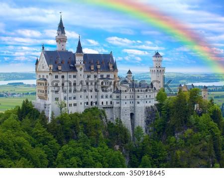 Rainbow over castle Neuschwanstein in Bavarian Alps - stock photo