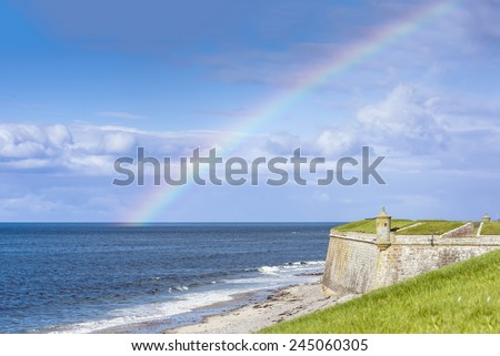 Rainbow over Fort George, Scotland - Fort George is a large 18th century fortress near Ardersier, to the north-east of Inverness in the Highland council area of Scotland.  - stock photo