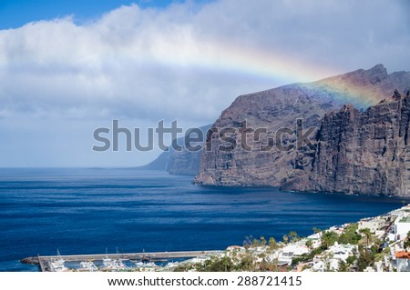 Rainbow over Los Gigantes cliffs and resorts, Tenerife - stock photo