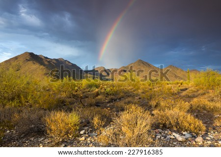 Rainbow over mountains in the Sonoran Desert near Phoenix, Arizona - stock photo