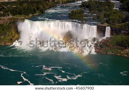 Rainbow over Niagara Falls - stock photo